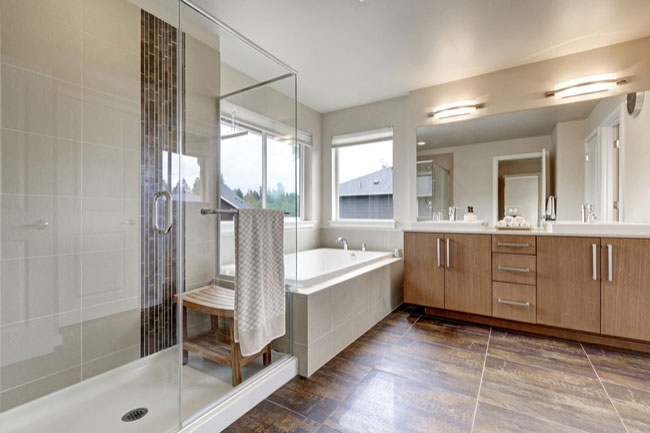 Find out how to build a walk in shower from start to finish. With new glass shower doors, your shower enclosure will become an oasis.
