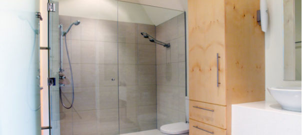 What type of glass is used for glass shower doors?
