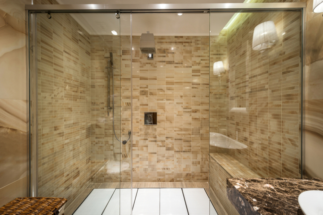 A large glass shower door, which creates a spa-like feel for your shower enclosure.