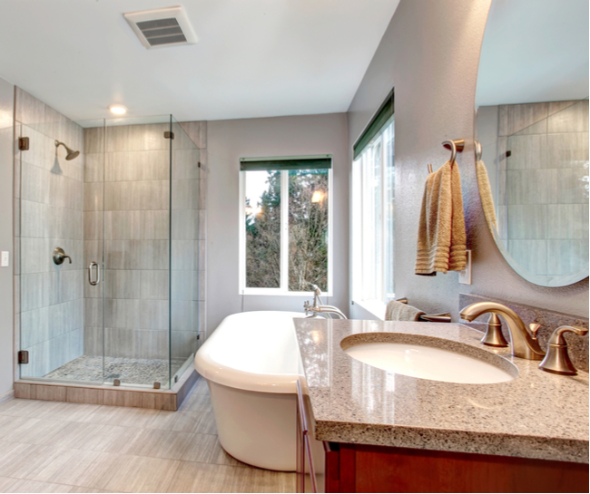 Bathroom with both a shower enclosure glass shower door and a bathtub.